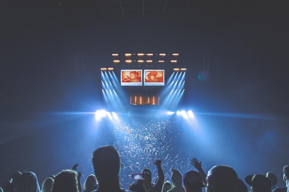 people under blue lights