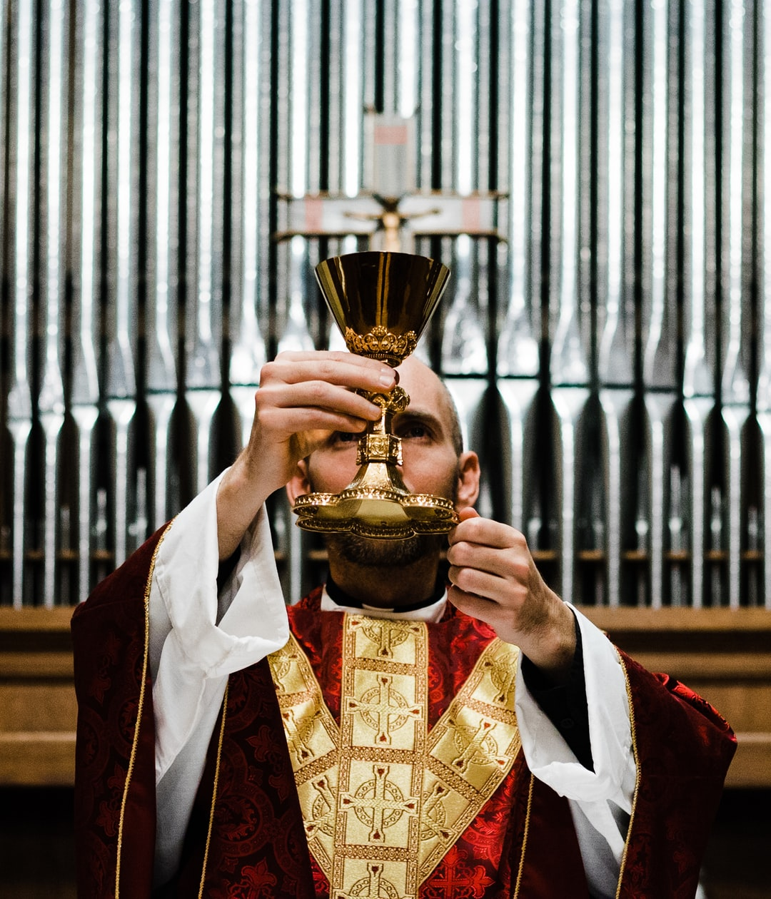 The consecration of the wine into the Precious Blood of Jesus Christ during a Catholic Mass.