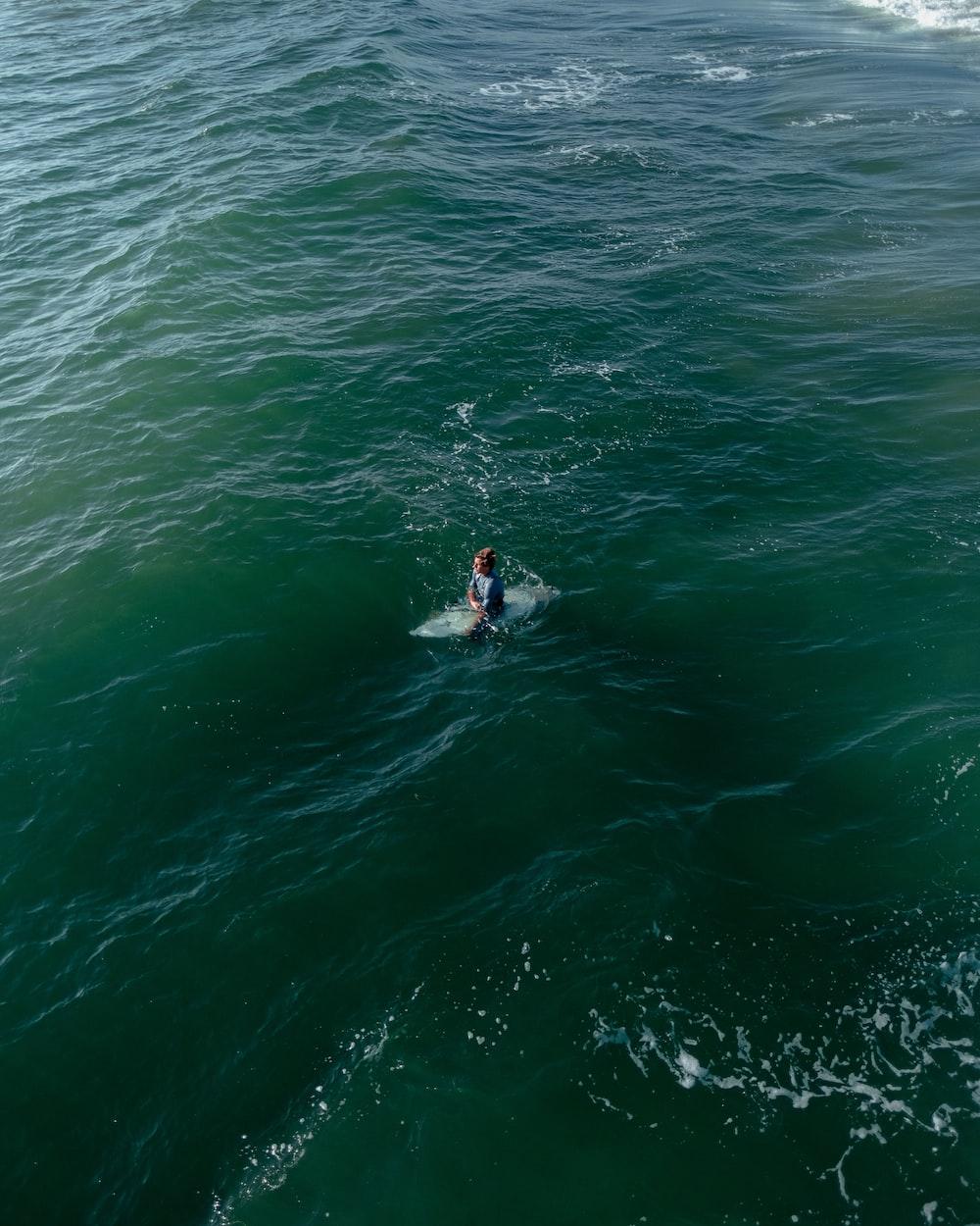 perspn on surf board