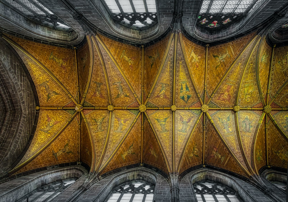 selective color photography of gold and gray church ceiling