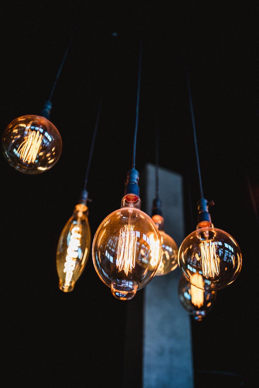 several turned-on yellow Edison bulbs