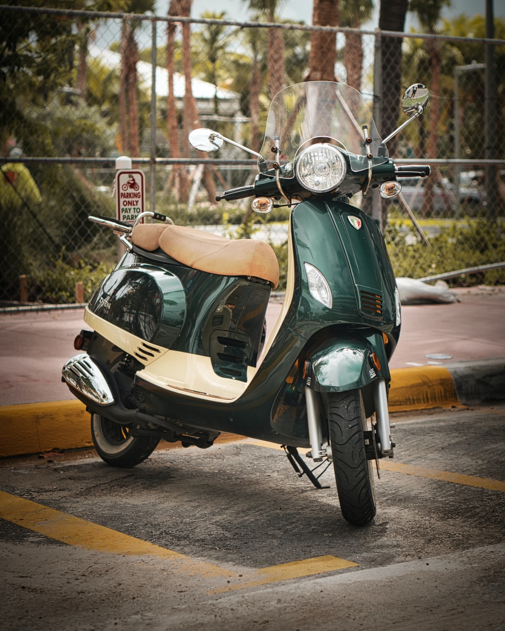 green and beige motor scooter