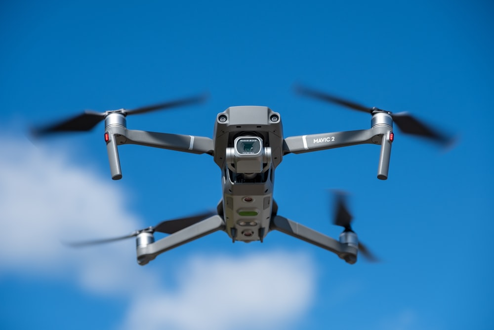 time lapse photography of a flying gray drone