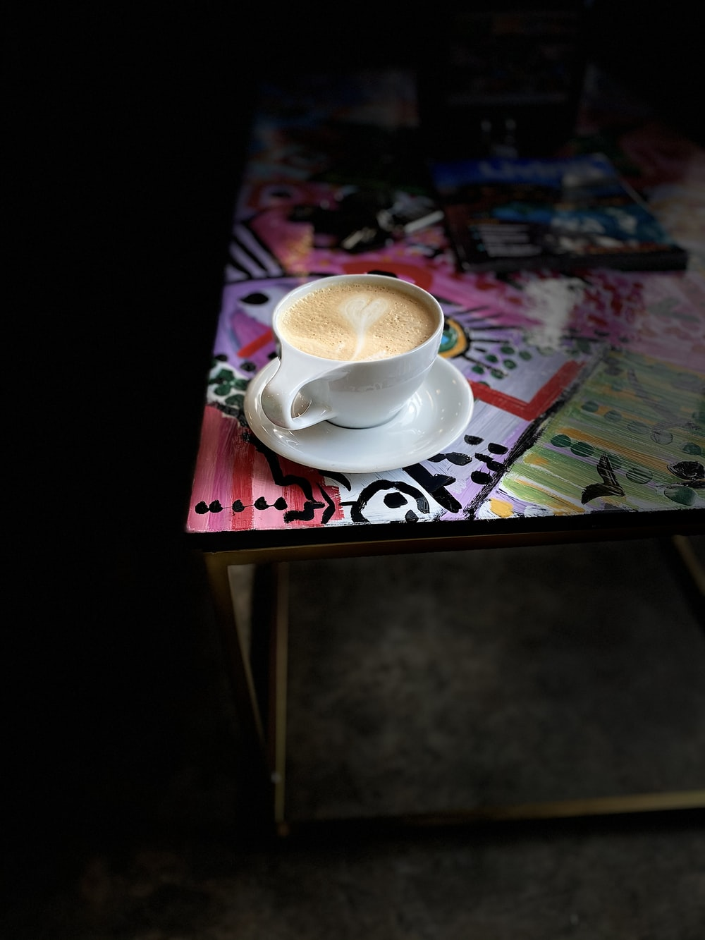 cup of latte on saucer