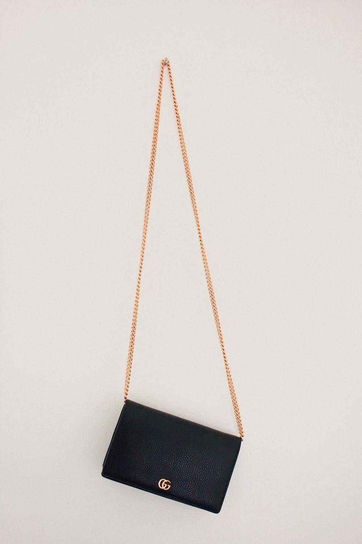 black Gucci leather crossbody bag