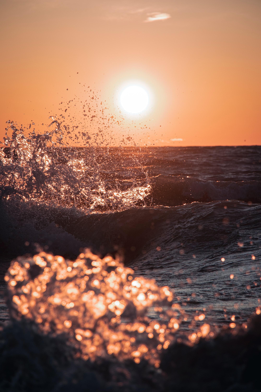 Waves splashing during sunrise