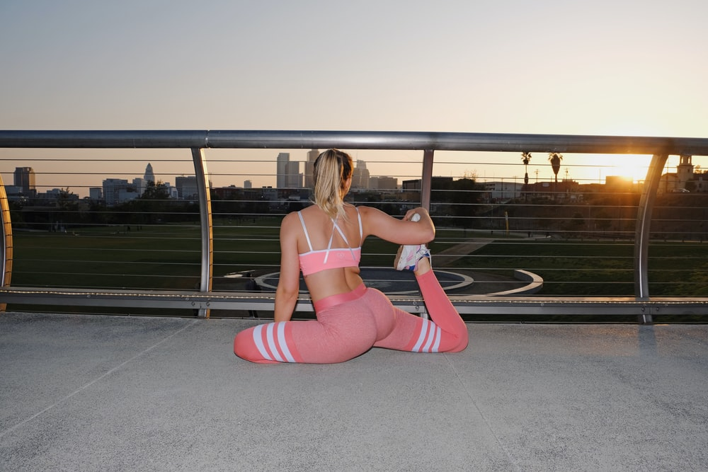 woman doing yoga at a balcony
