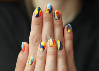 woman's nails with manicure