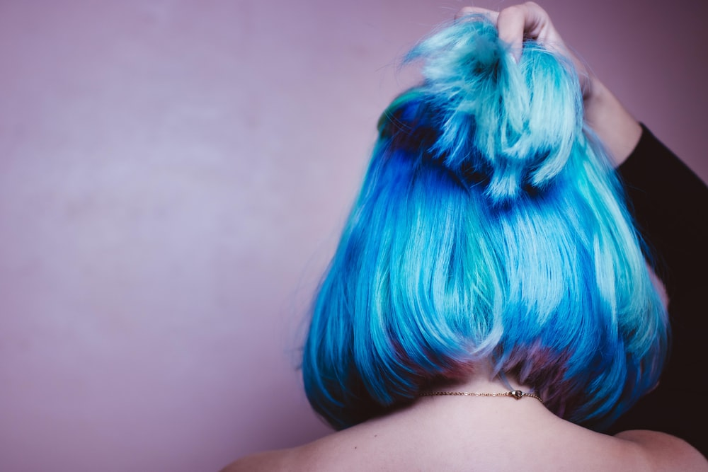 person with blue and white hair