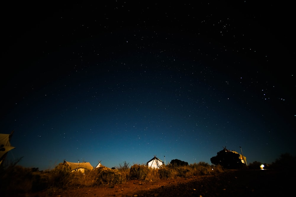 photography of brown tent during nighttime