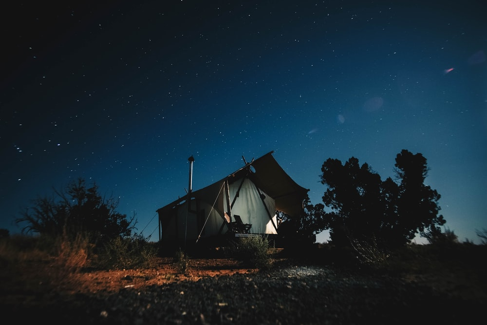 black and gray house under blue sky at nighttime