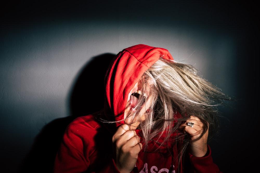 person wearing red hoodie PTSD Symptoms
