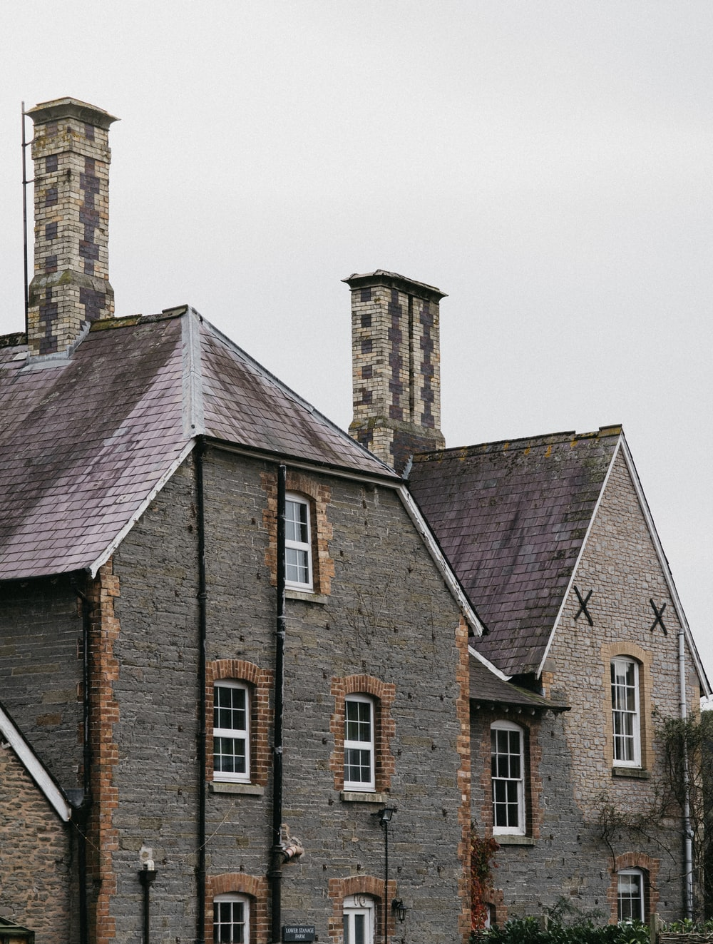 two gray stone houses