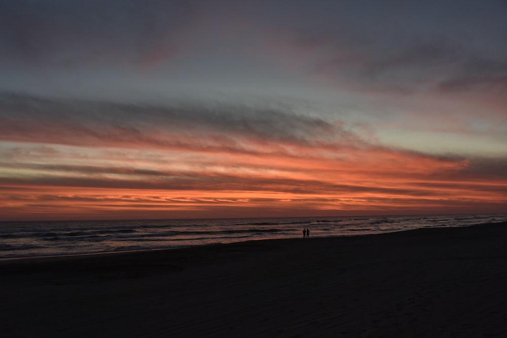 silhouette of person on seashore