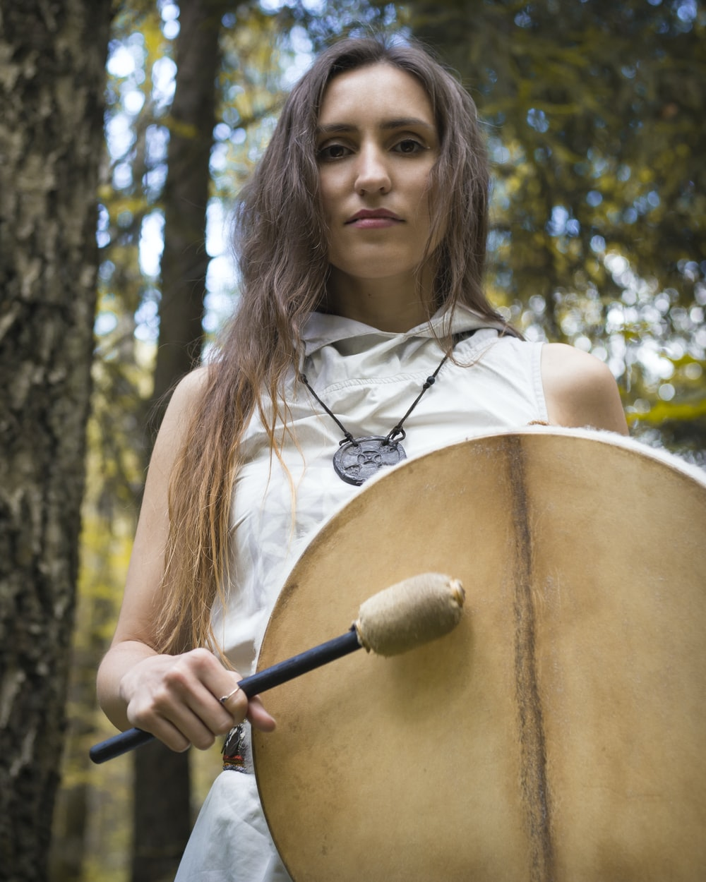 woman playing drum instrument