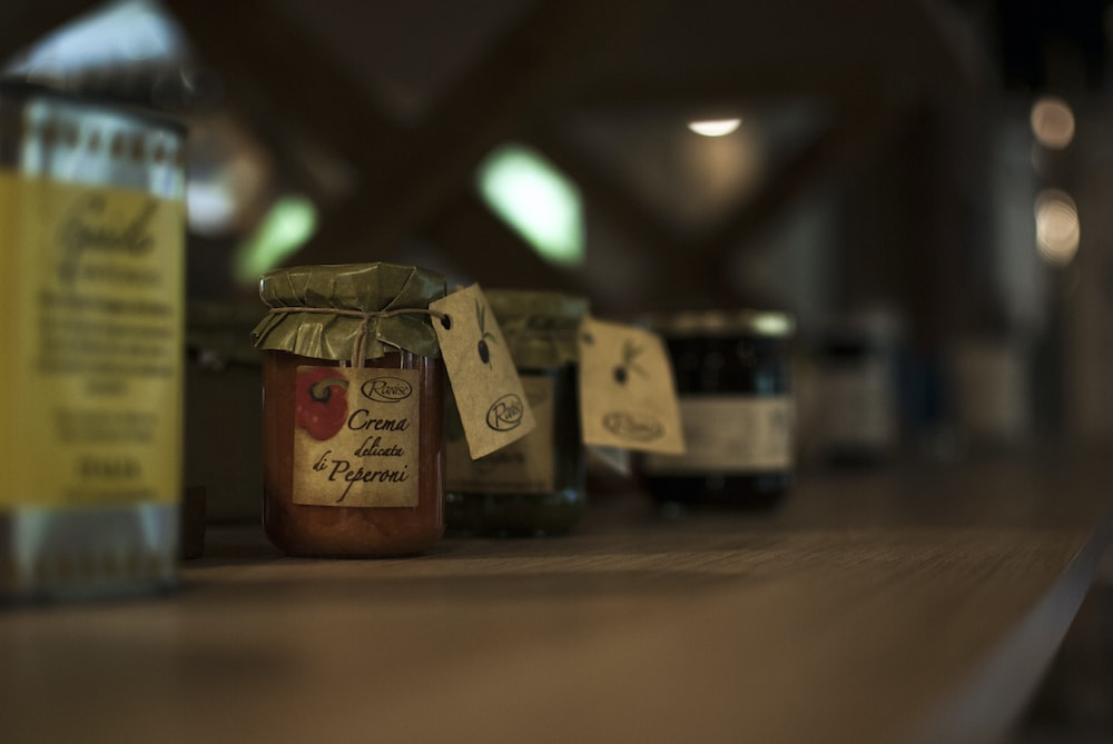 selective focus photography of variety flavored jars of spread