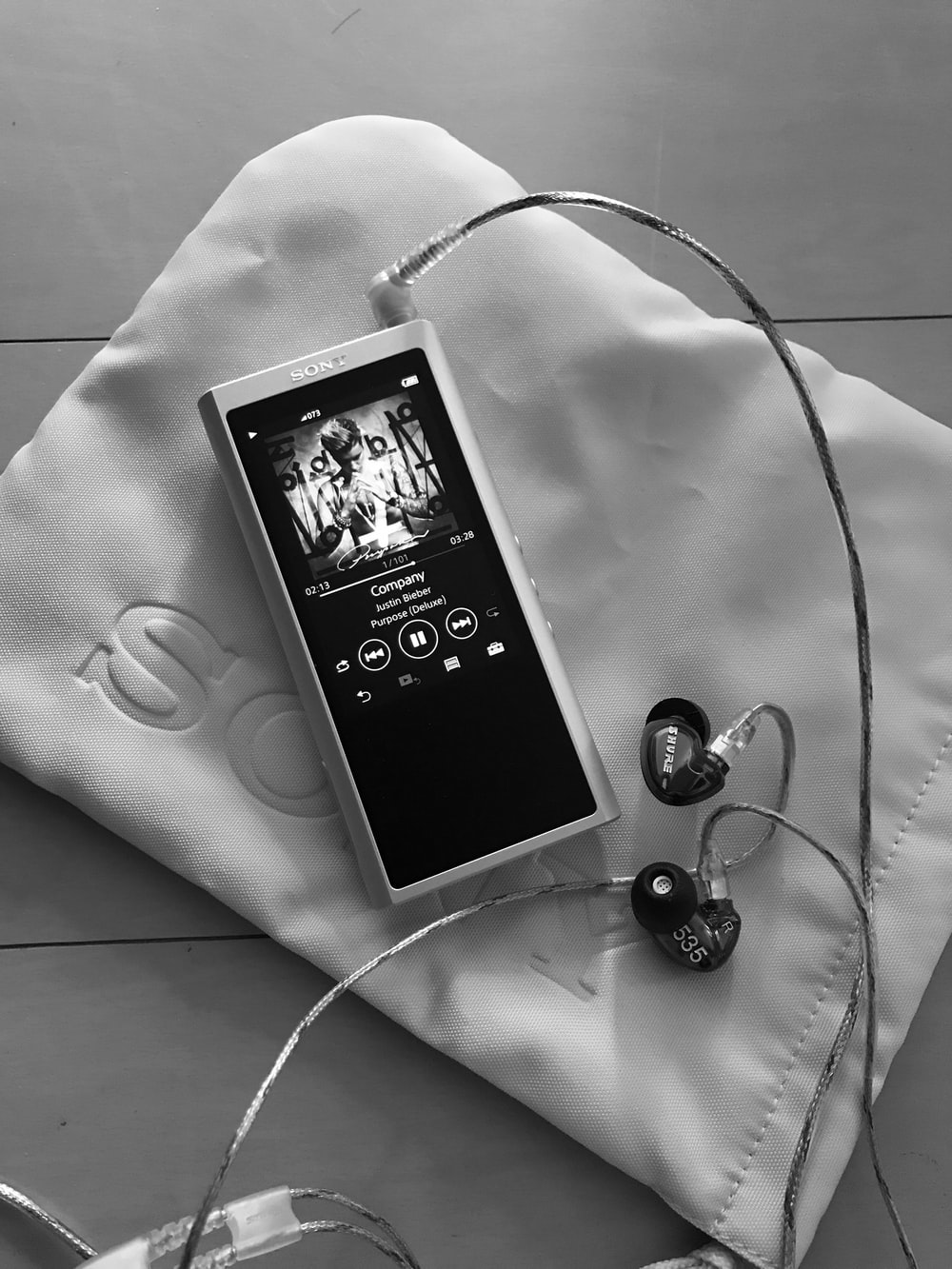 music player that is turned-on on bed