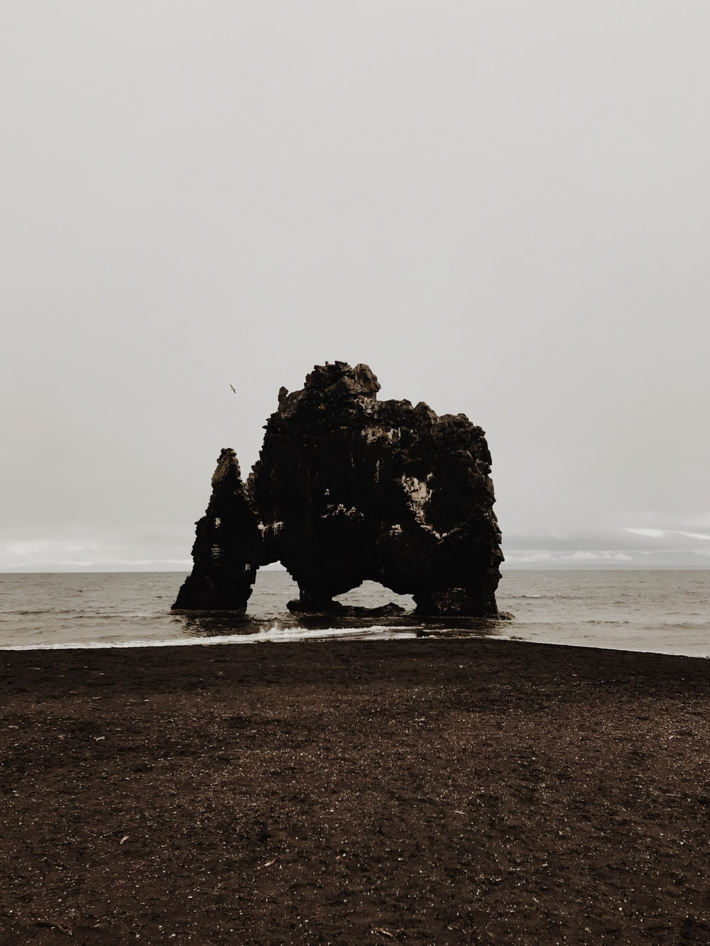 rock formation by the seashore during daytime