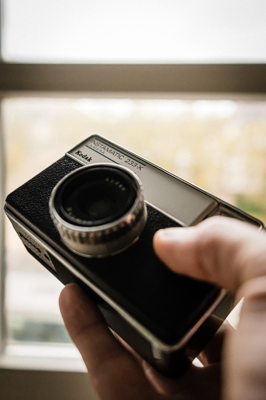 black and silver Kodak Instamatic 233X camera