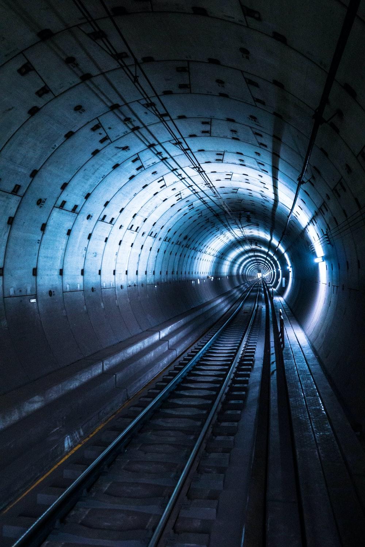 gray concrete train tunnel