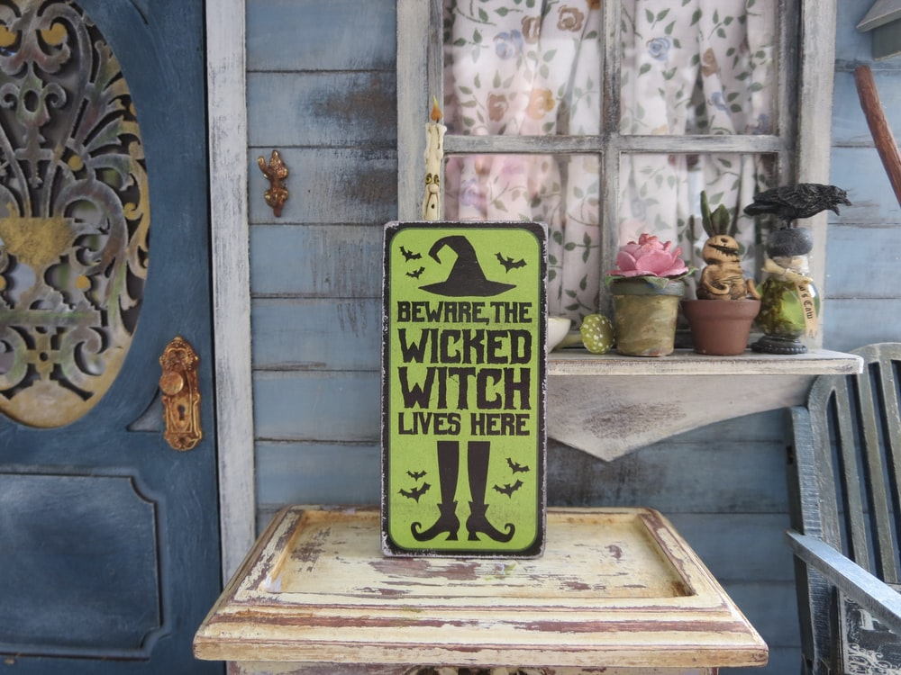 green and yellow wooden wall decor