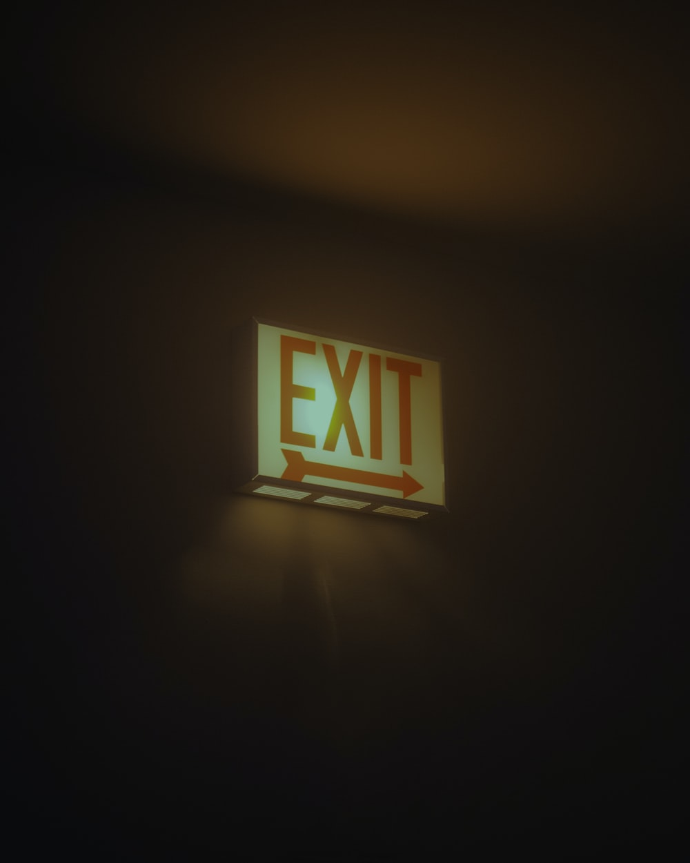white and red Exit signage