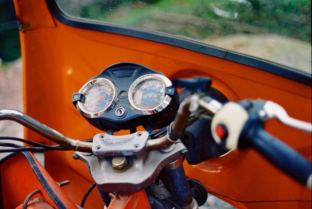 blue and black motorcycle speedometer