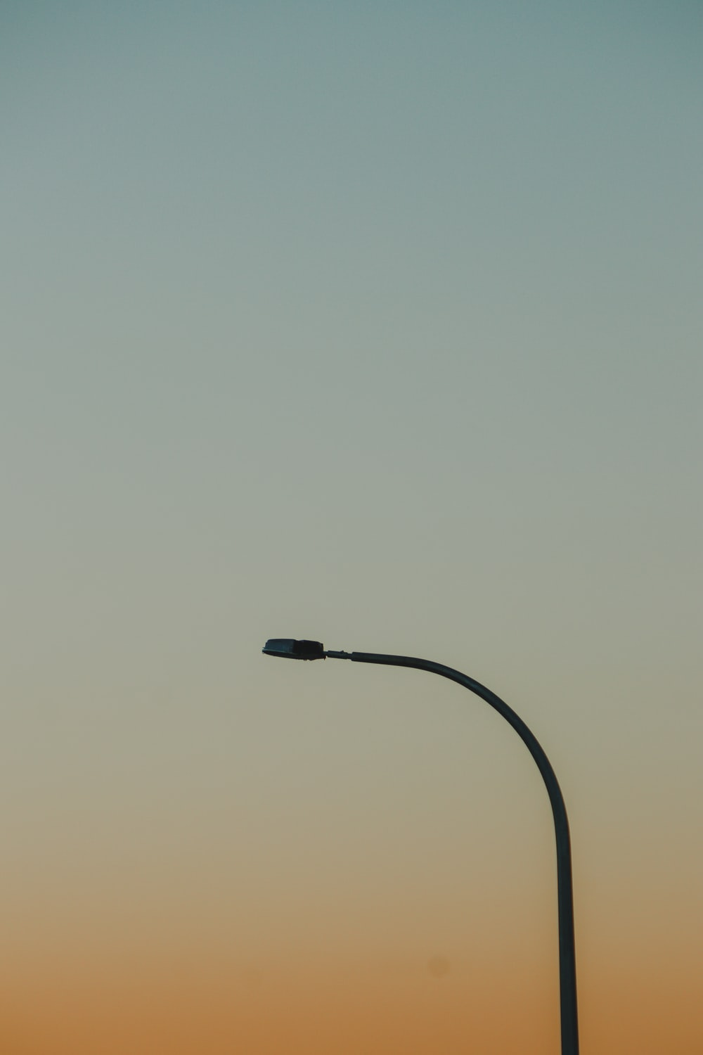 black lamppost during day