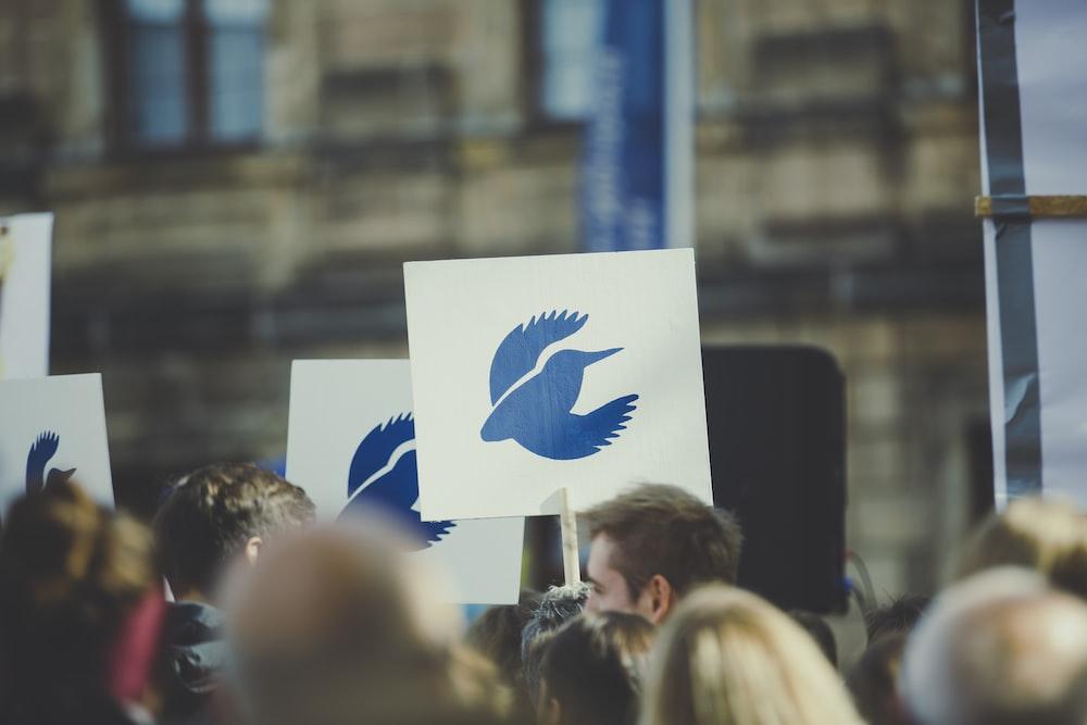 white signboard with blue bird logo