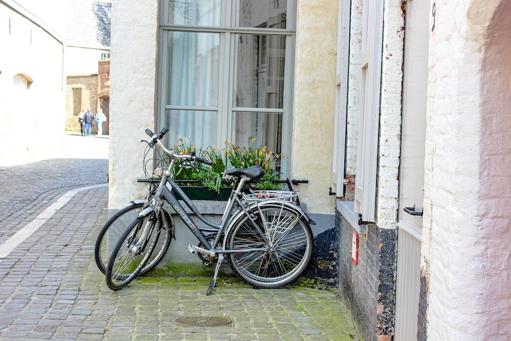 black bicycle beside window
