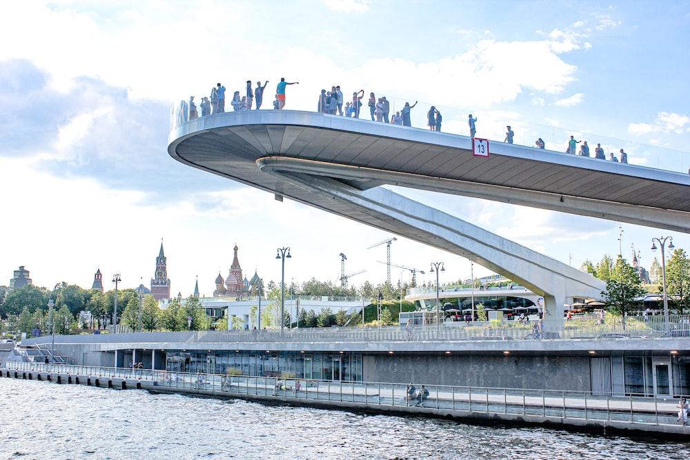 people gathering on bridge