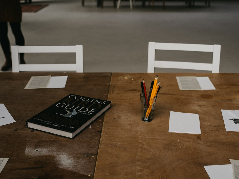 two black and white wooden boards