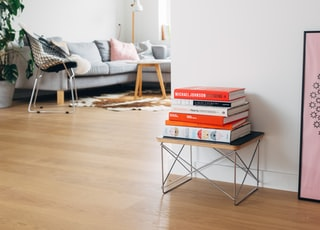 books on brown wooden stool
