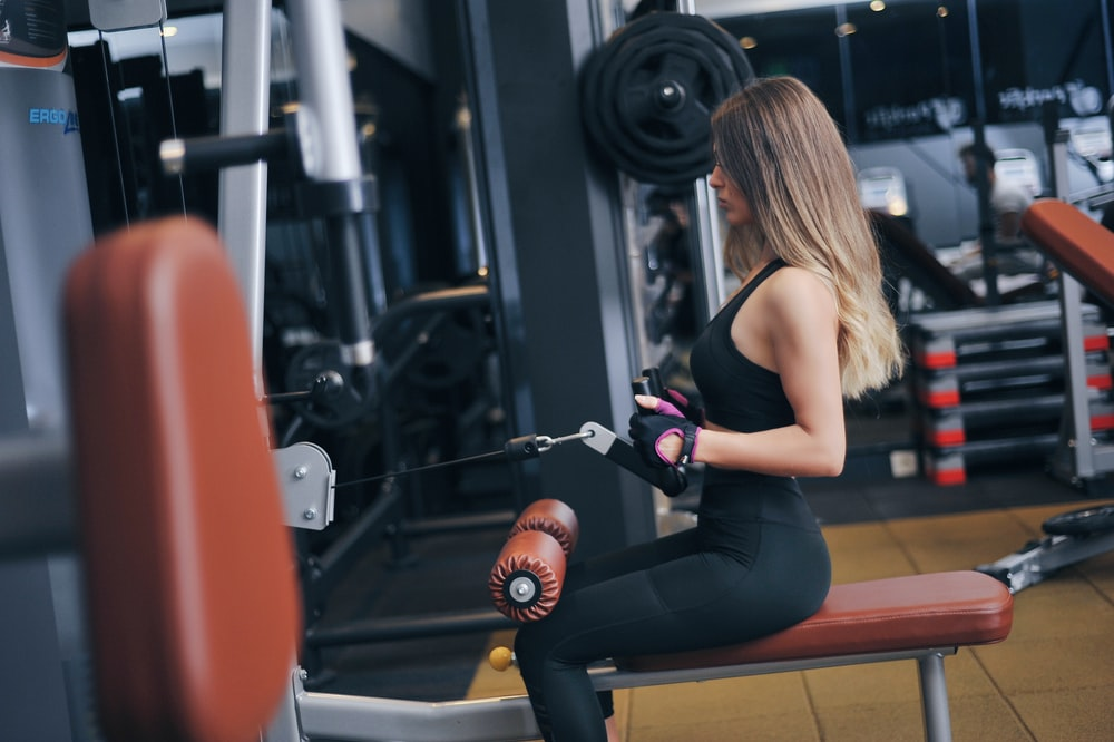 woman sitting on exercise bench