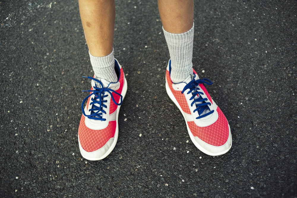 red-and-white running shoes