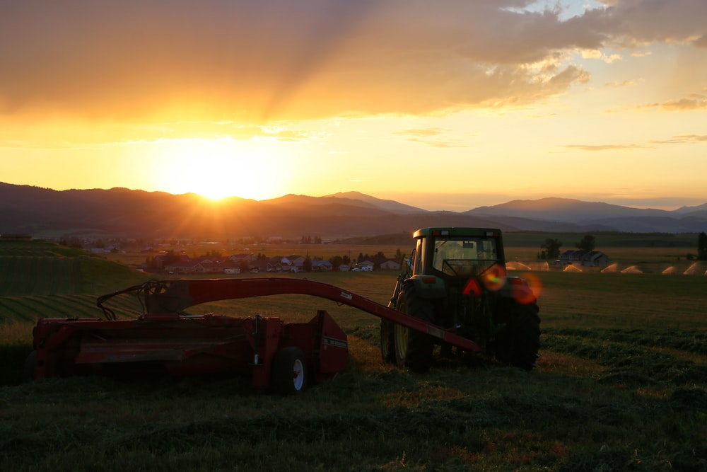 farming equipment at the field during day