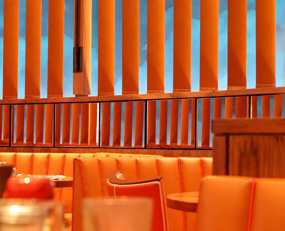 orange themed dining area with no people