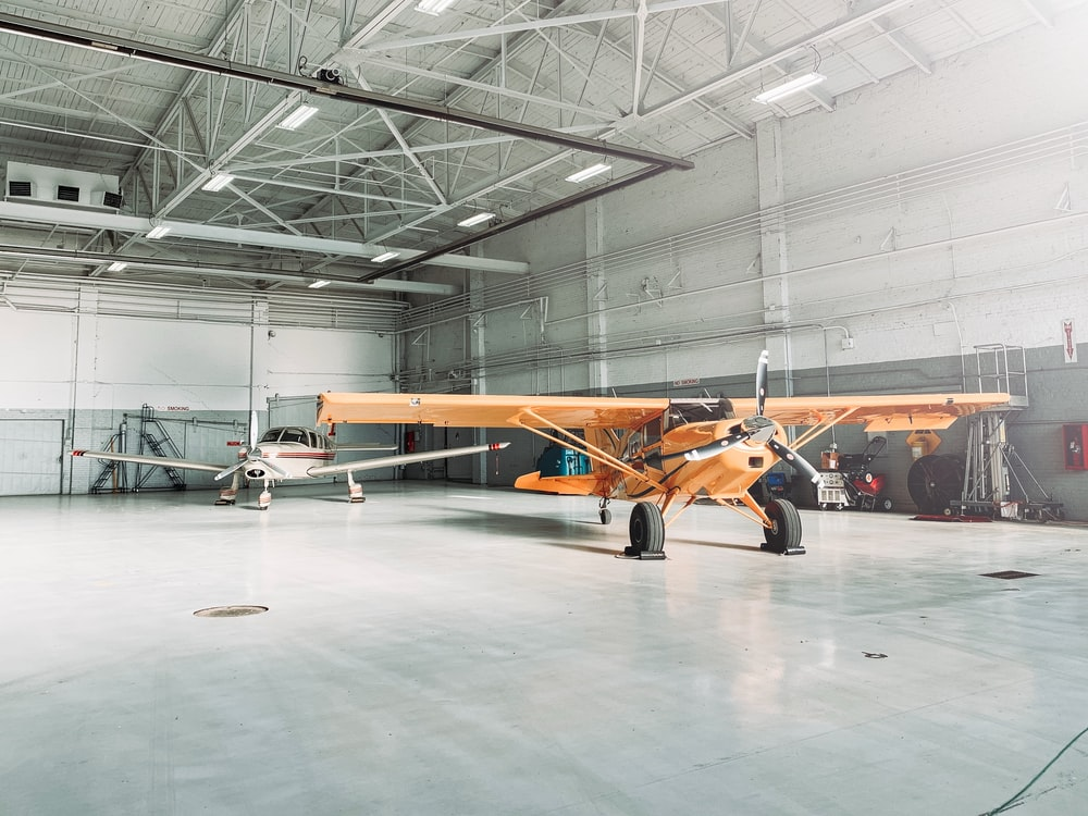orange biplane