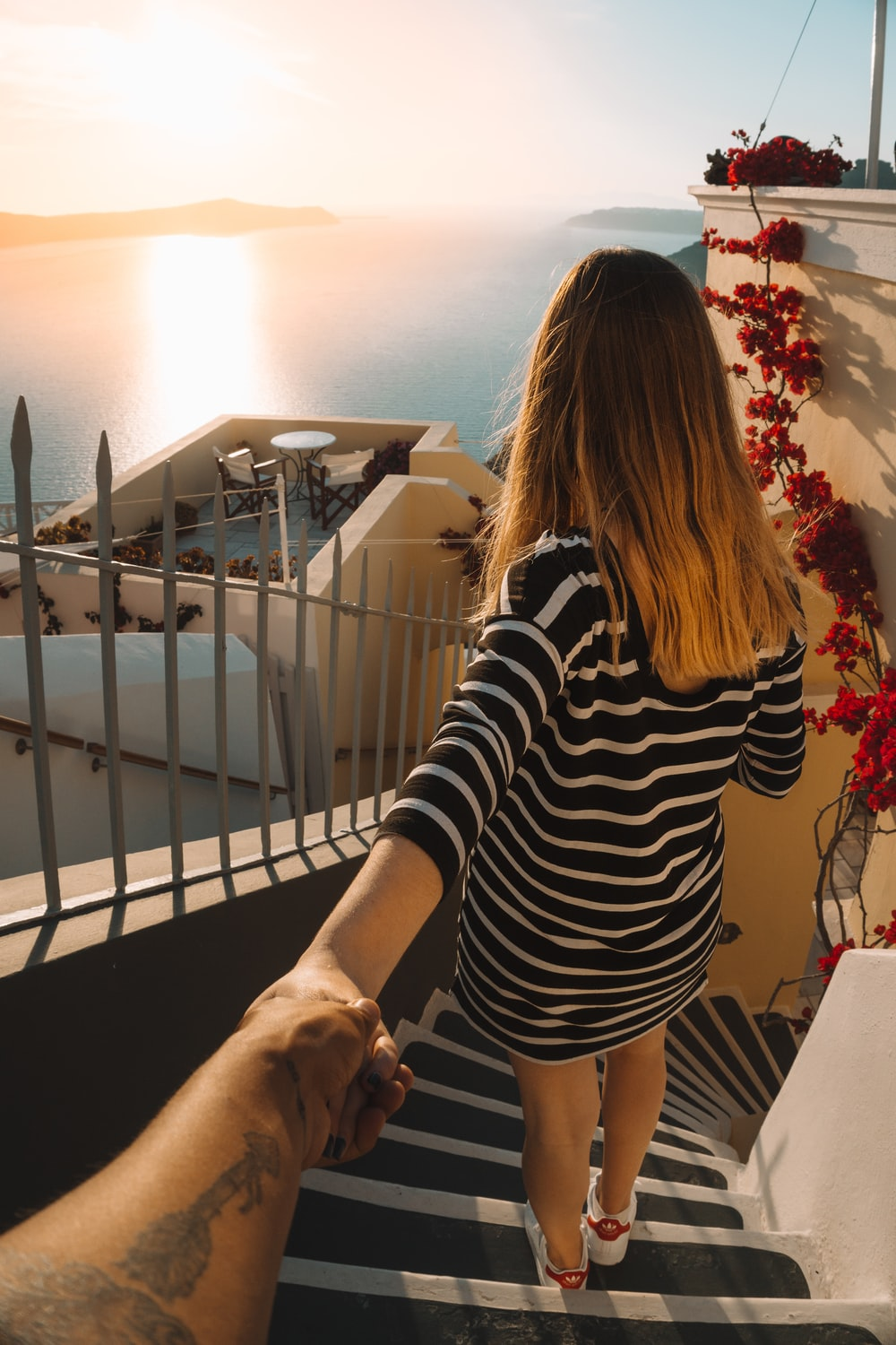 person holding woman hand