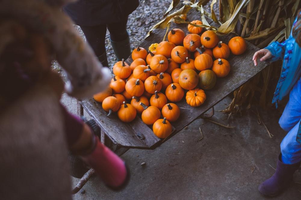 orange pumpkin lot on table