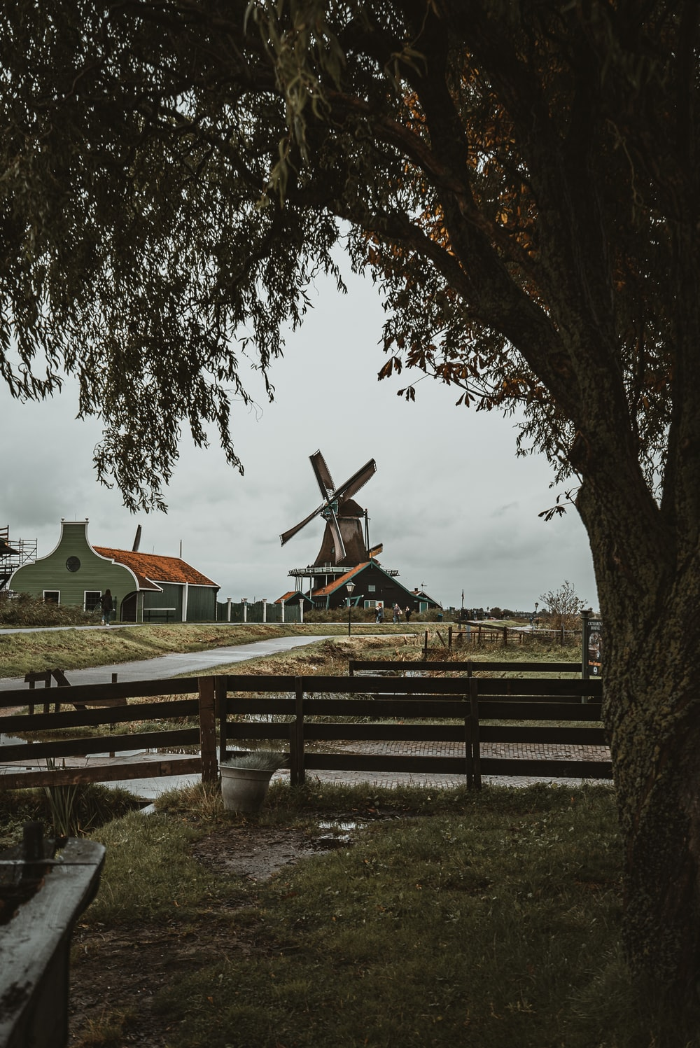brown and grey windmill during daytime