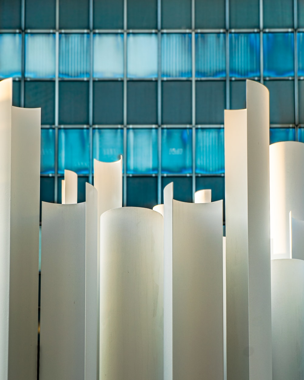 blue glass walled high-rise building