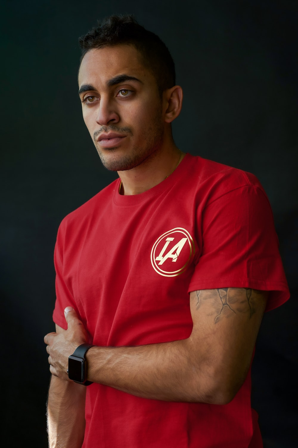 man wearing red with white crew-neck t-shirt standing
