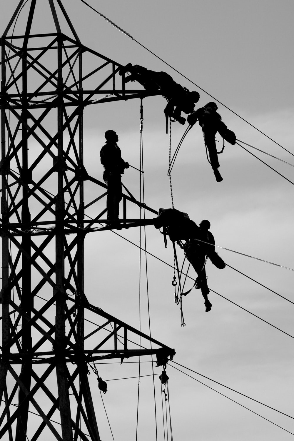 man fixing the transmission tower