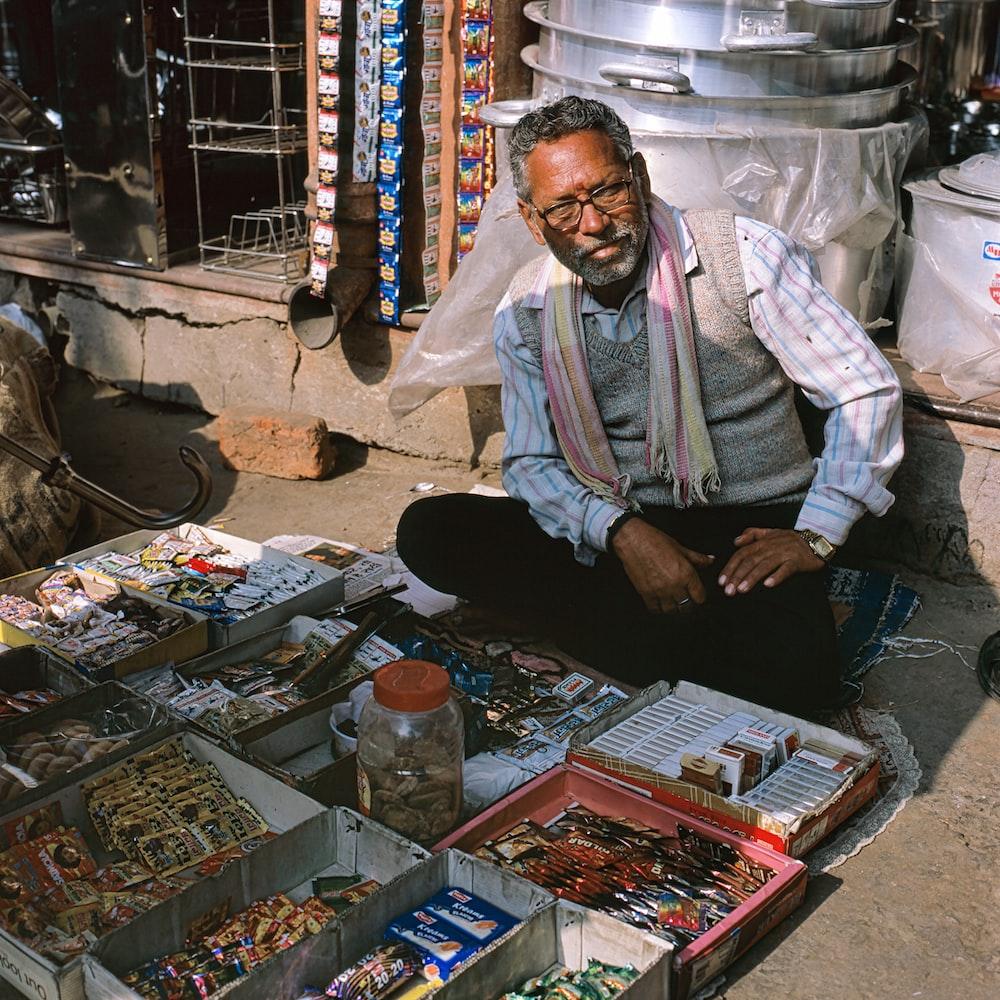 man seilling items on sidewalk