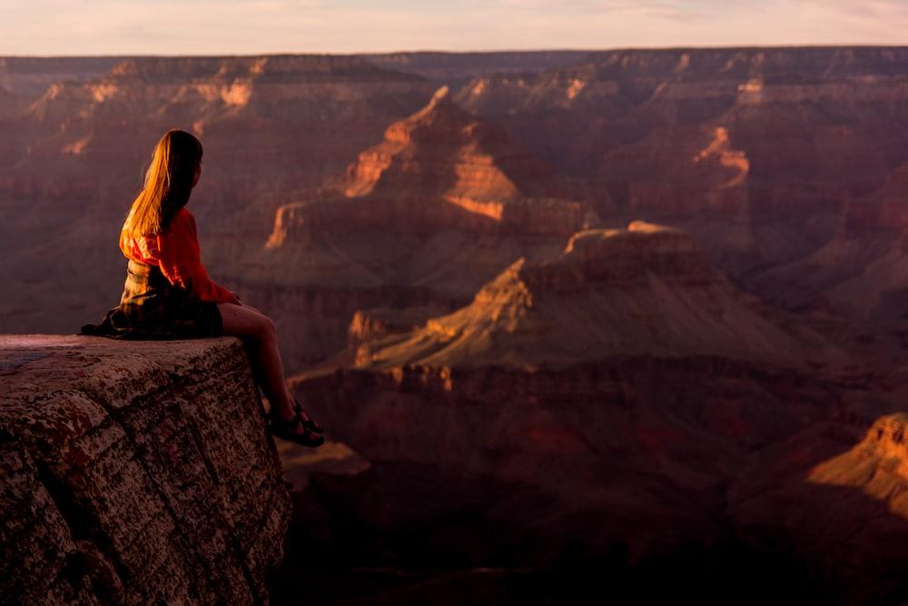 woman on rock edge