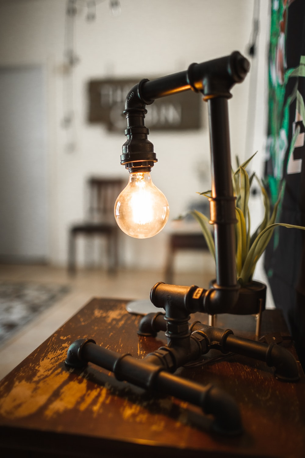 black pipe table lamp on wooden surface
