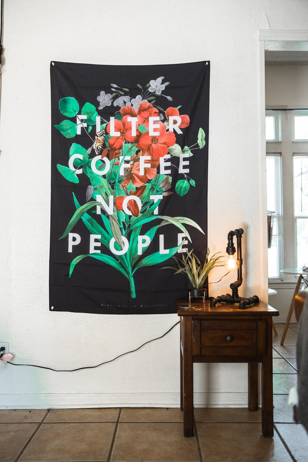 multicolored floral banner on wall