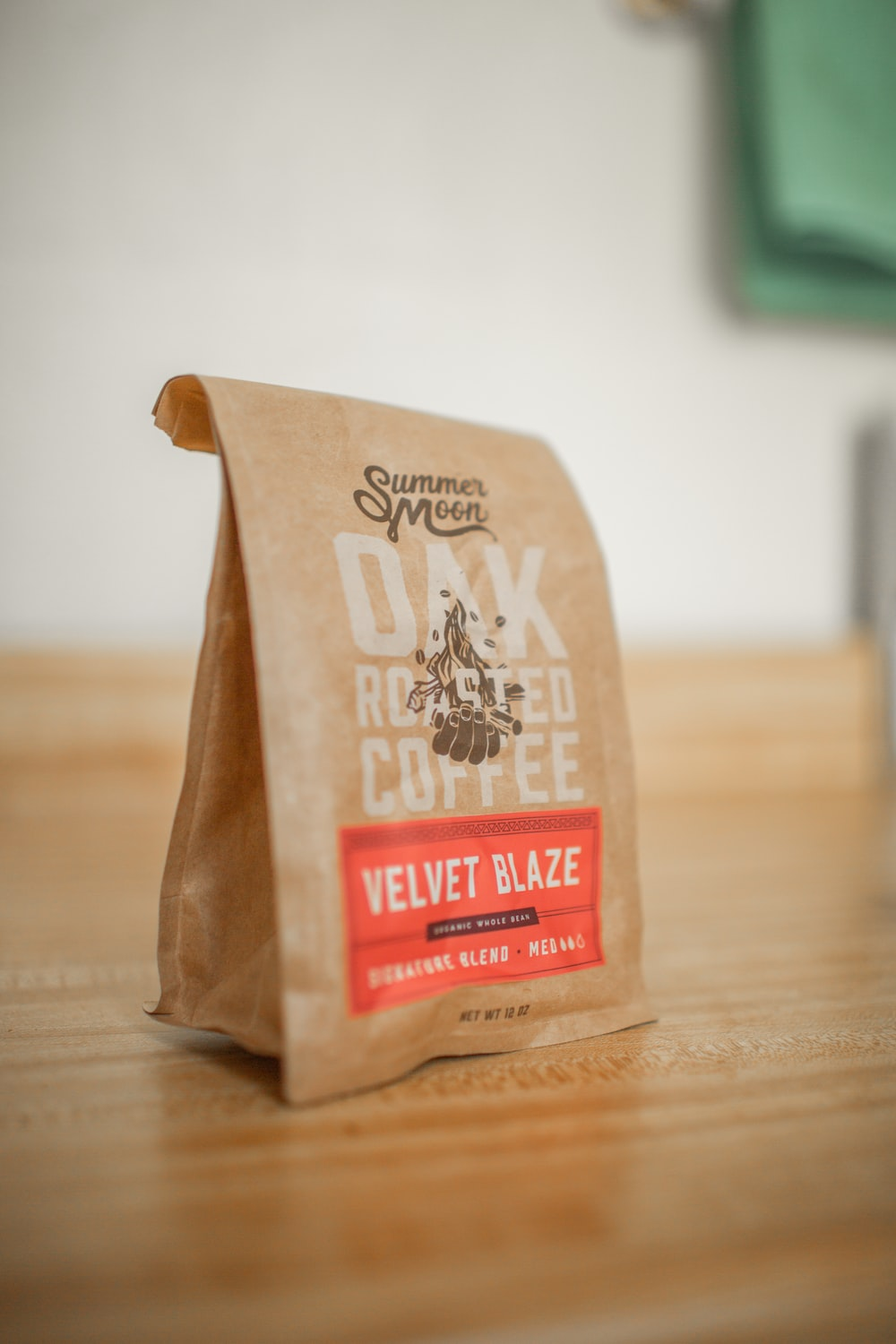 shallow focus photo of brown paper bag
