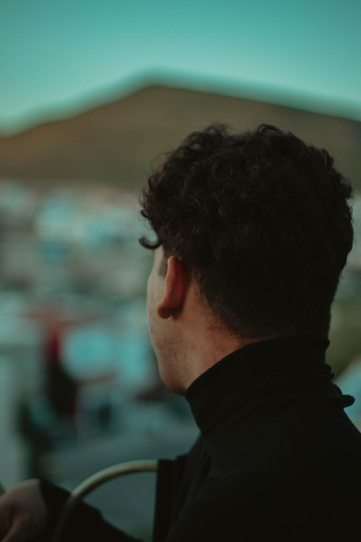 man wearing black turtleneck top during daytime